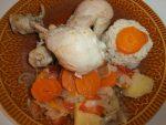 Pollo con tomates y patatas
