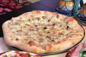 Pizza de queso brie con nueces